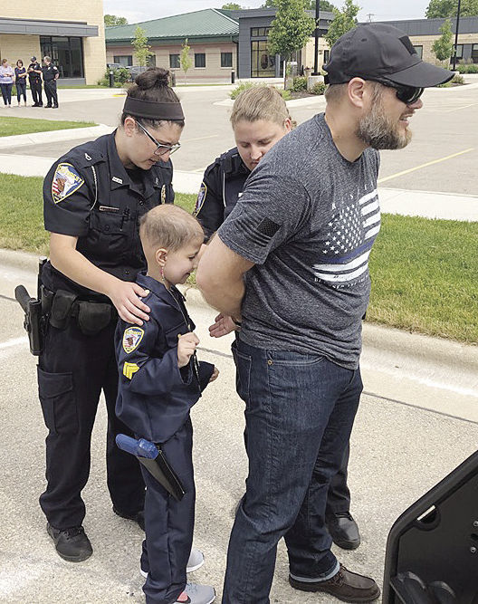 Childhood cancer patient becomes DeForest police officer for a day