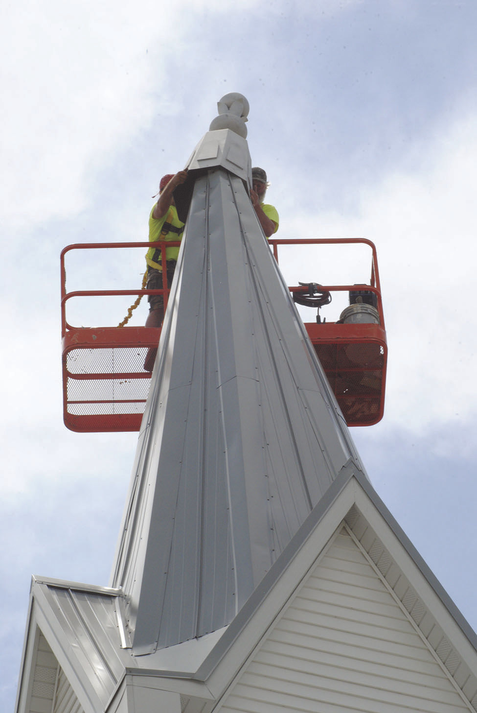 The little white church by the road receives final touch