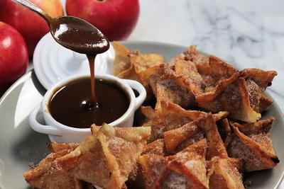 One-bite apple pies with caramel sauce