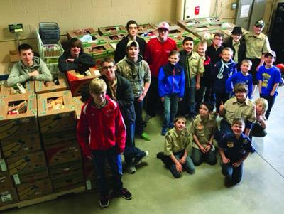 Boy Scouts and Cub Scouts donate food
