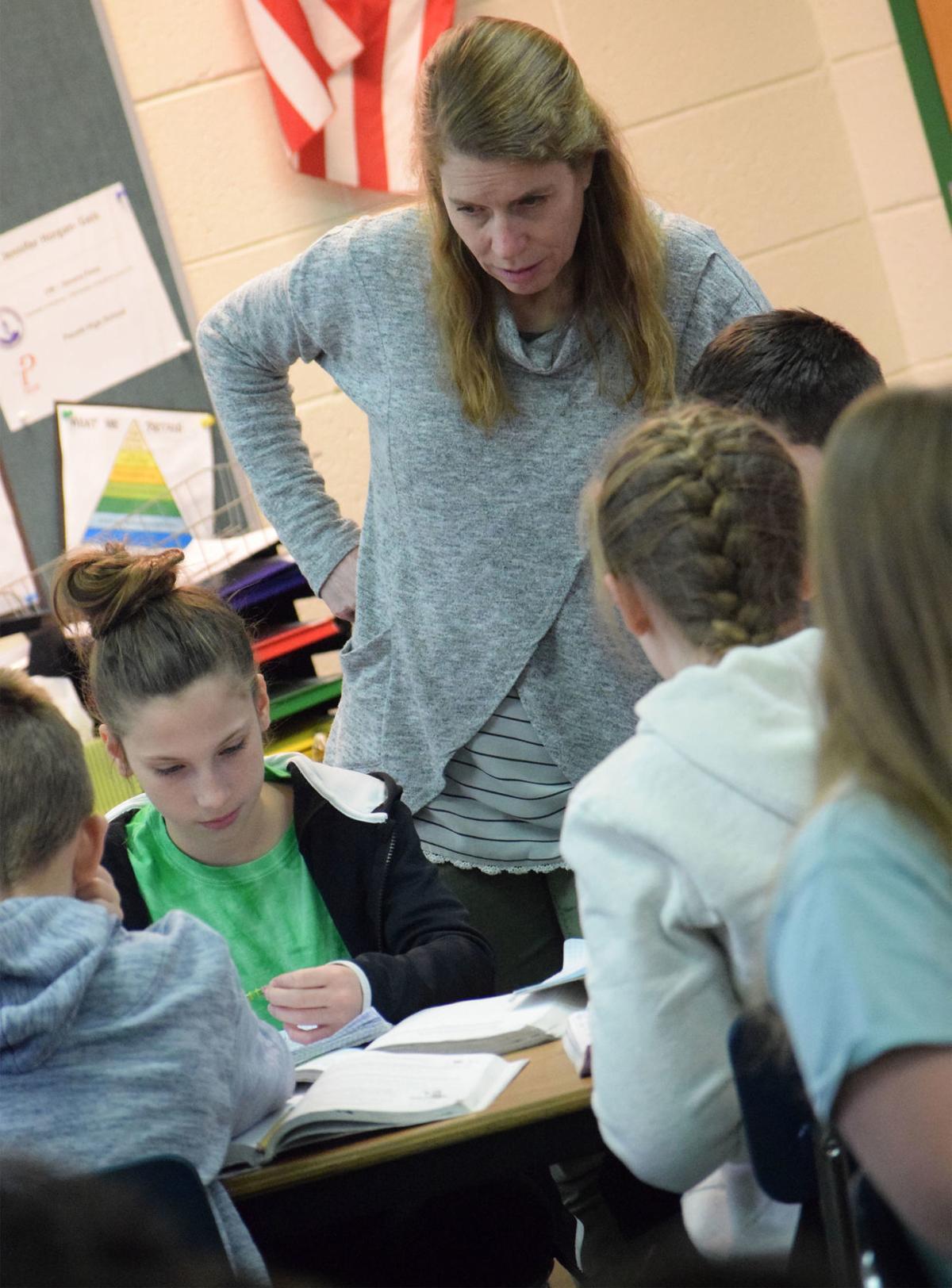 Higher Math: Cambridge middle school stays focused on improvement