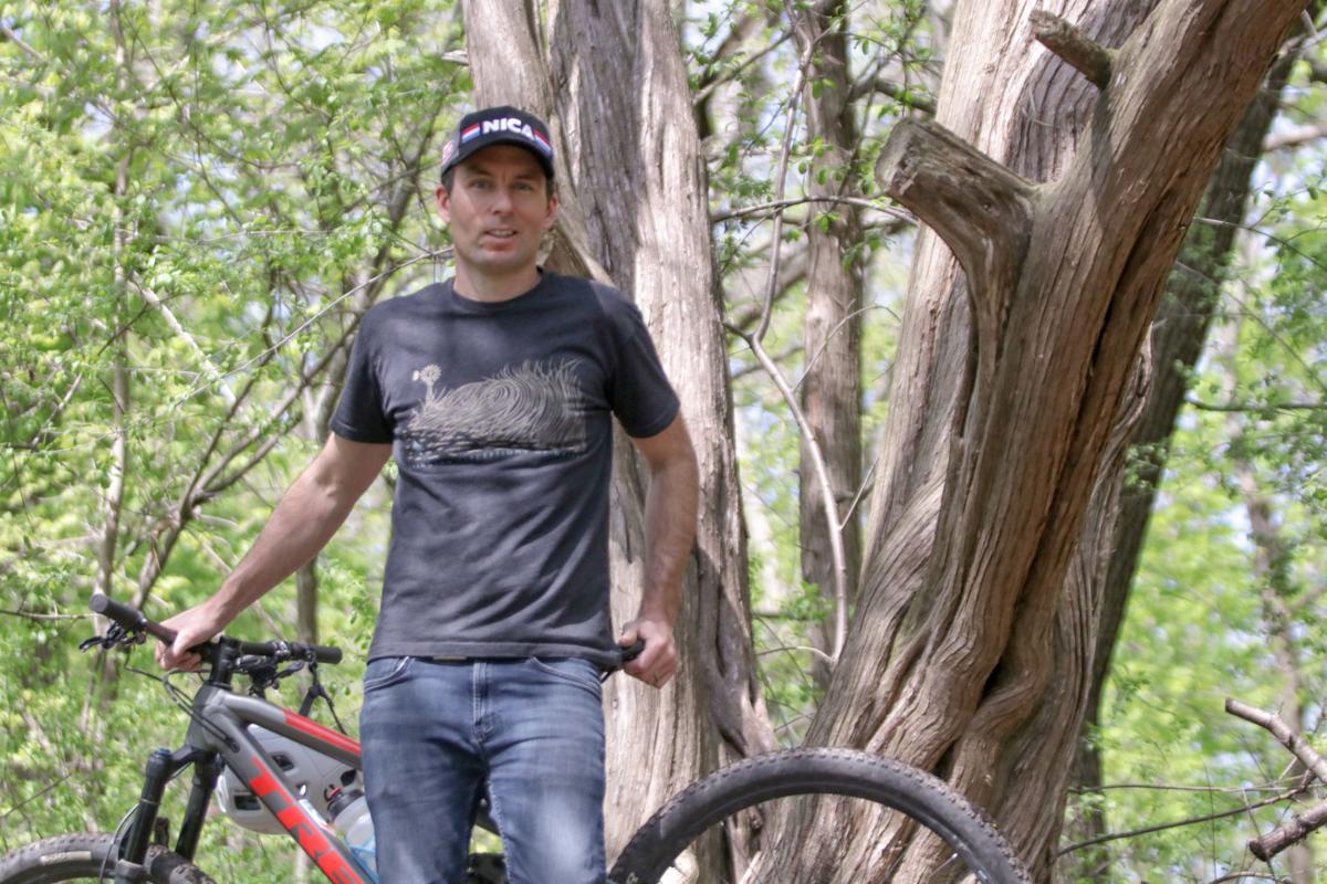 Tony Cooke and a cedar tree
