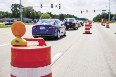 Traffic barrel with traffic signals over lanes