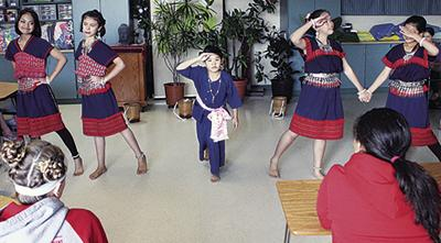 PMMS students watch Thai dance demonstration