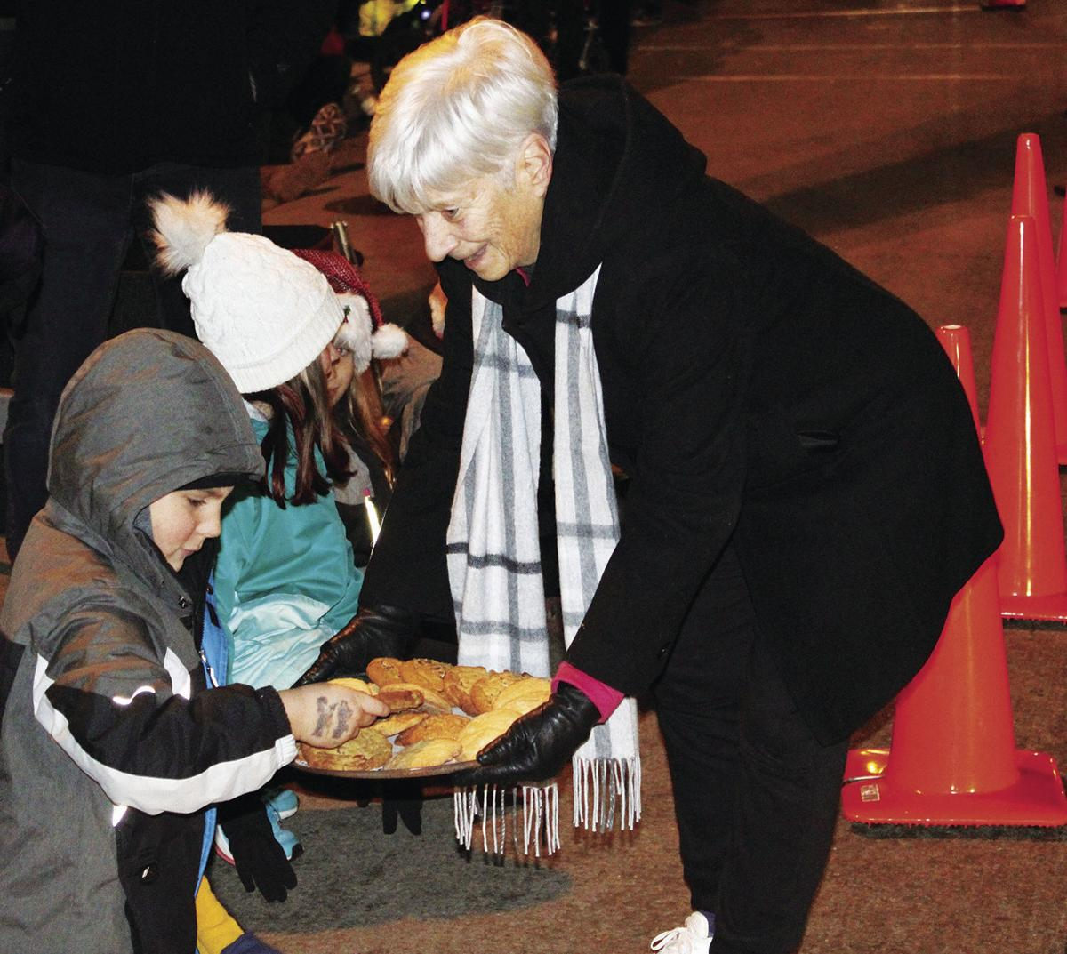 Handing out cookies at 2019 Tree Lighting