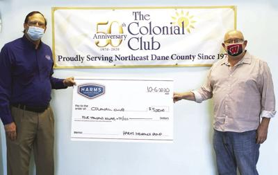 Harms Insurance donates $5,000 to Colonial Club