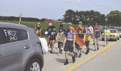 Protesters march through Lake Mills