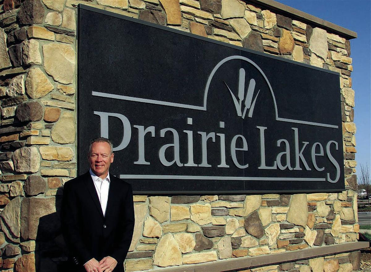 Chad Fedler at Prairie Lakes sign (2015)