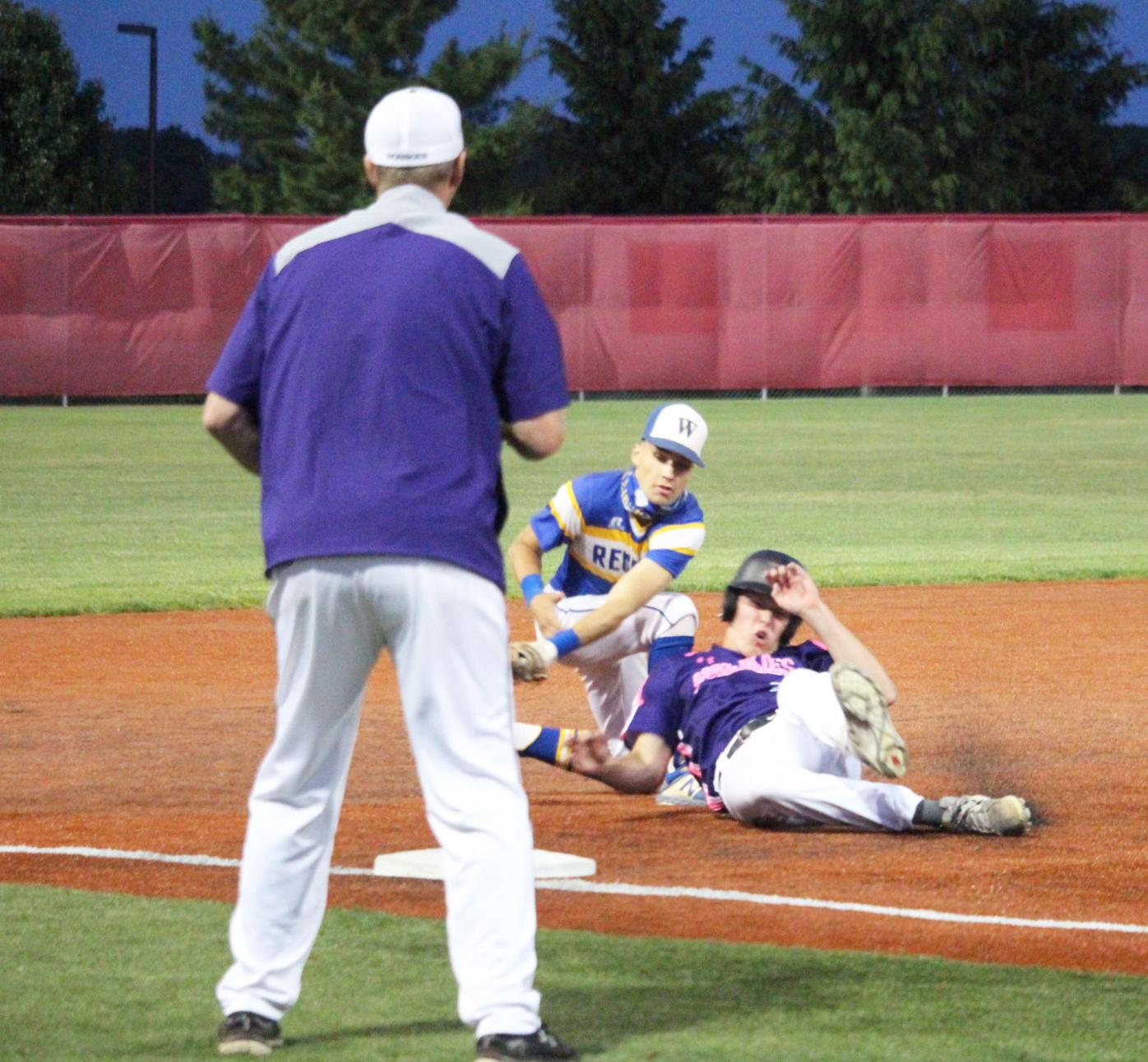 Sliding into third base