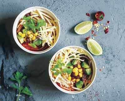 Mexican chicken tortilla soup with corn, beans and avocado.
