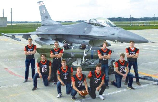 Senior football players and jet