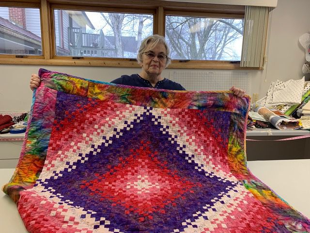 Pin, stitch, connect: Local quilters sew warmth