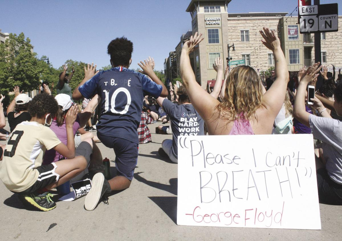 Hundreds protest George Floyd's death: I can't breathe