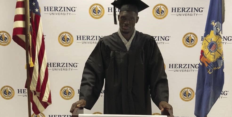 Richard Onyait Graduation