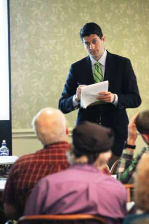 Photoy by Michael Gouvion | Milton Courier.  Congressman Paul Ryan, R-Janesville, takes notes while listening to a concern from a 1st District constituent at The Gathering Place.