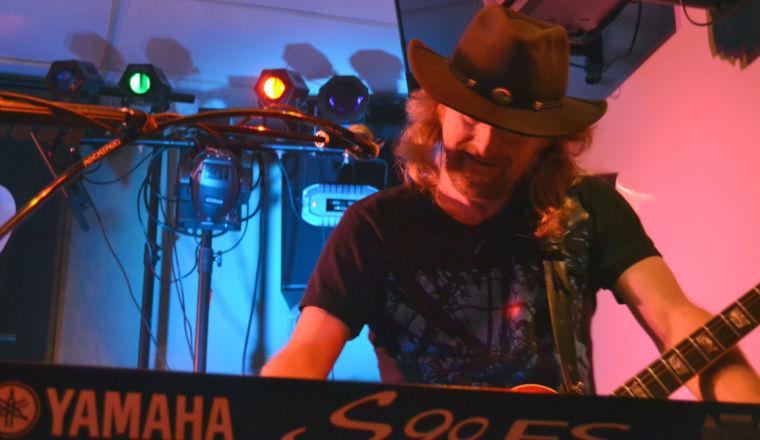 Chris Boyden on piano/guitar