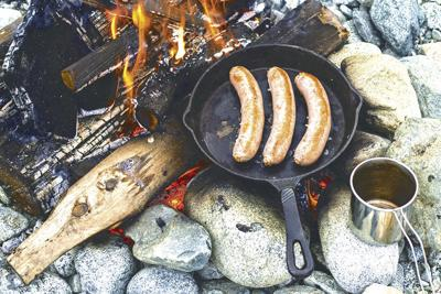 Sausages cooking