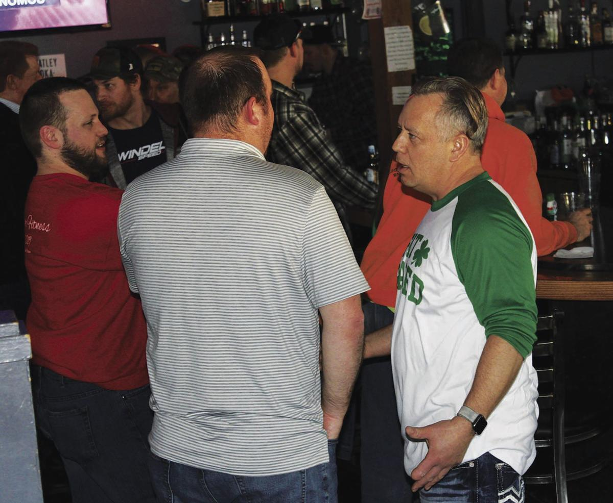 Steve Daly talks with patrons on St. Pat's Day