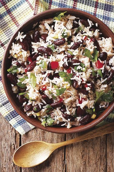 Rice with red beans and vegetables in a bowl close-up. vertical top view