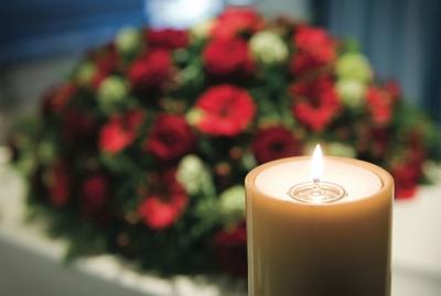 Candle and Memorial Floral Arrangement