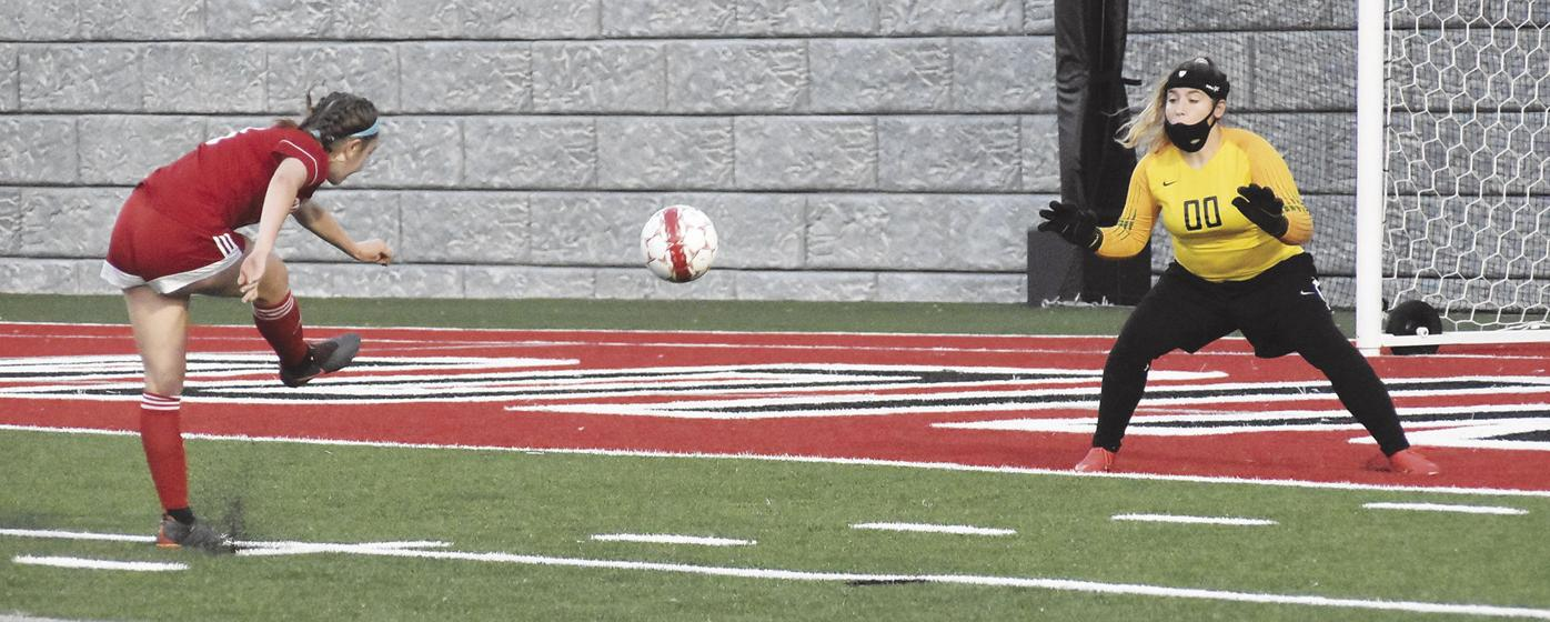 Erin Davidson takes shot on goal against Janesville Parker