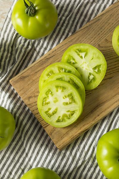 Raw green organic tomatoes