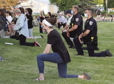 BLM event / Officers kneel