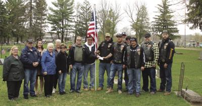 Donation helps cemetery purchase flags