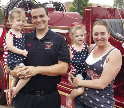 Cory and Abby Barr with daughters and Stoughton Fire Truck