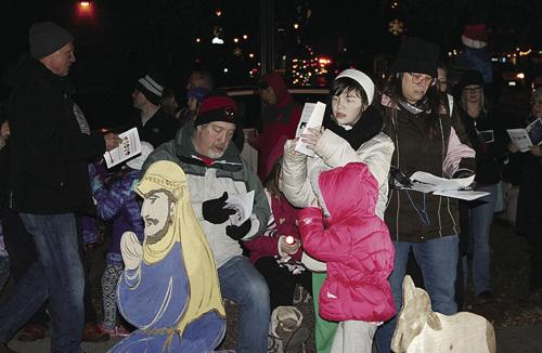 Caroling at the Creche