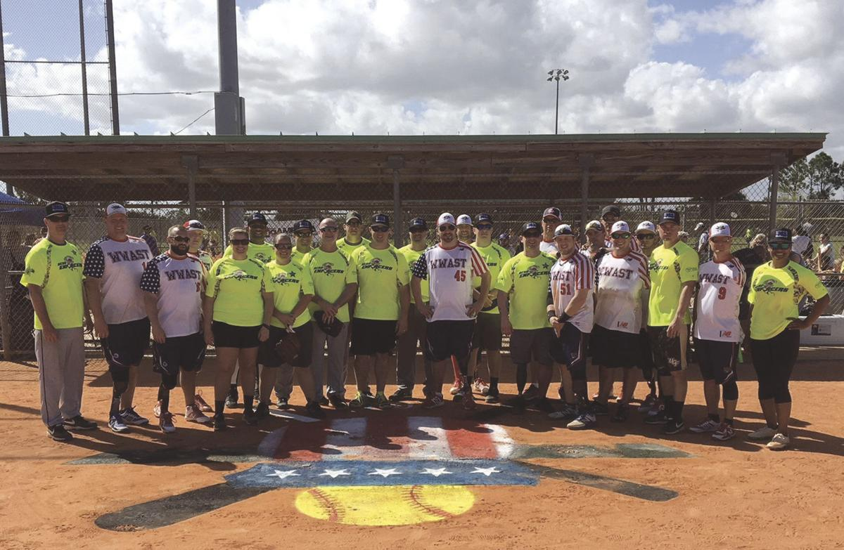 Softball event raises $10,000 for young amputees