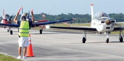 Space Coast Regional Airport - Warbird Museum - piper cubs on the runway
