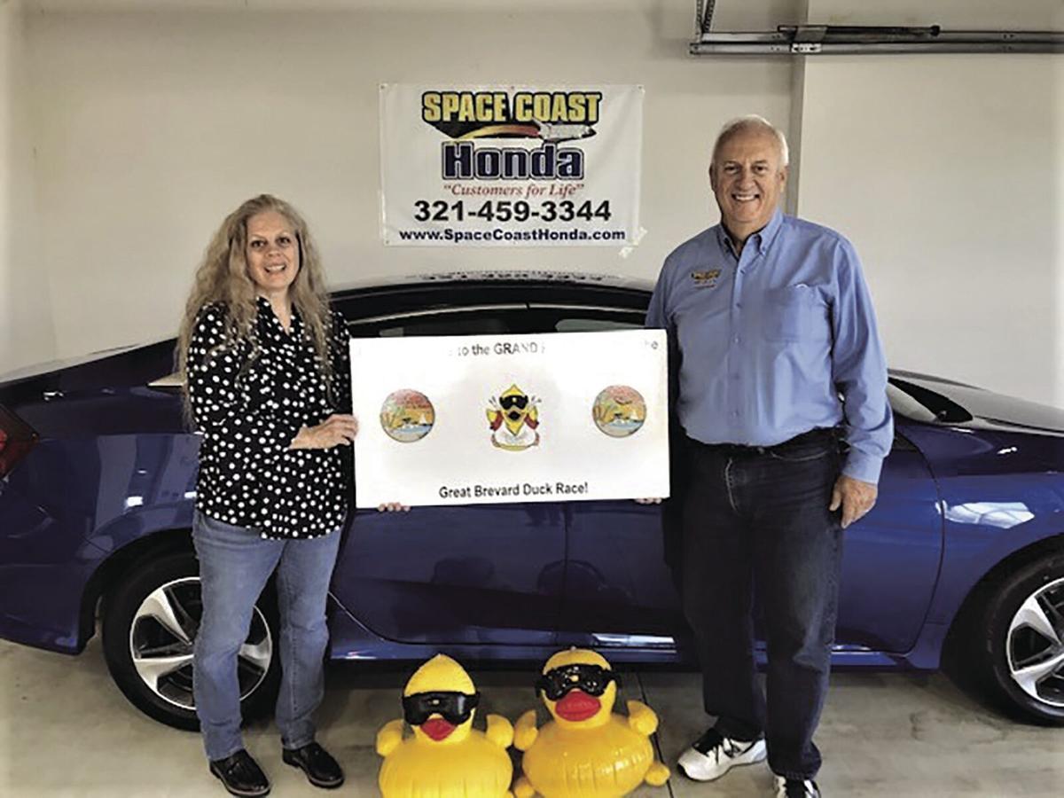Grand Prize winner Bonnie Galloway with Space Coast Honda owner Scott DeMasso