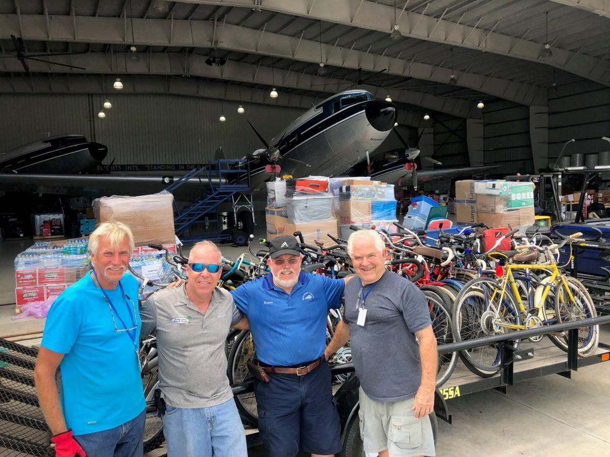 Malcolm Allen with bikes donated to Bahamas