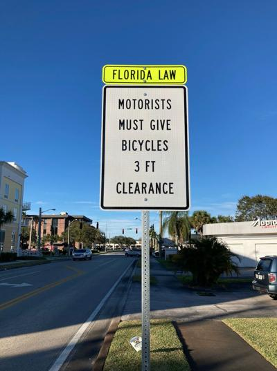 Indian River County's new bike safety sign at 6th Ave. near the Miracle Mile