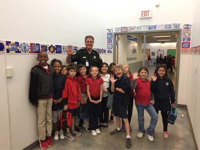 SRO - police in school - Indian River County  SRO with students