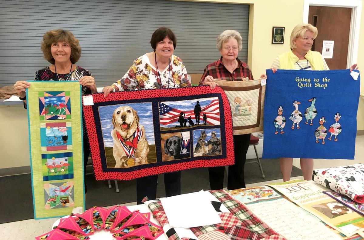 Sunbonnet Sue Quilt Guild members display show quilts