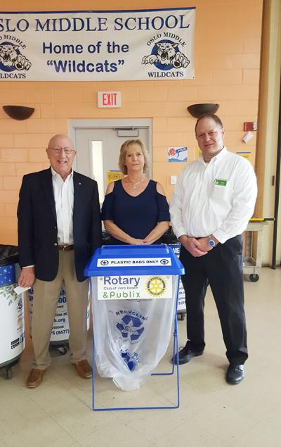 Recycle - Dan Compas, IRC Custodial Services Coordinator Ann Rieben, and Publix store manager Chris Ellis