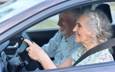 seniors driving in a car