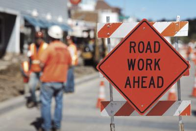 roads - road work sign construction workers