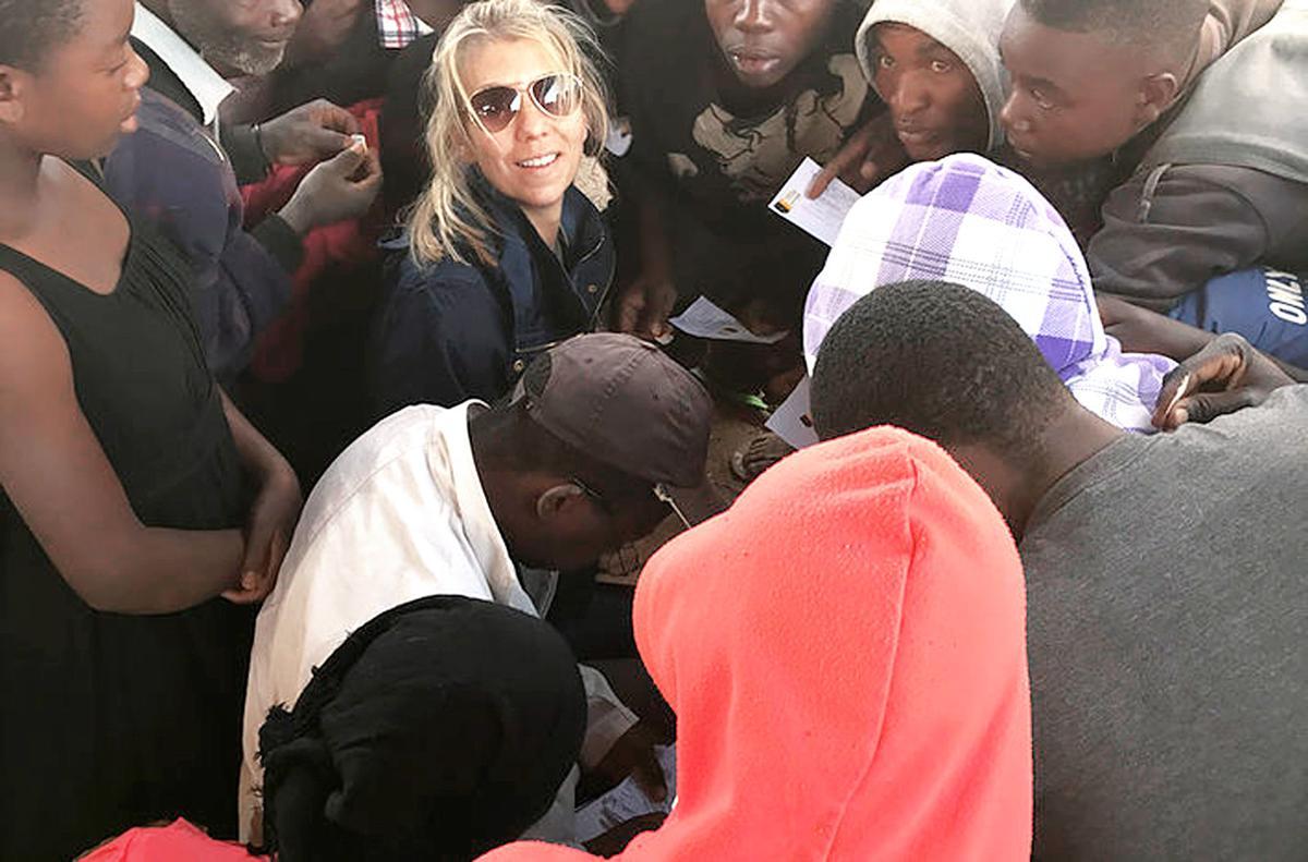 Rachel Clark coordinating rabies certificates during Malawian rabies vaccination clinic