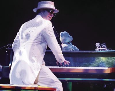Rus Anderson as Elton John