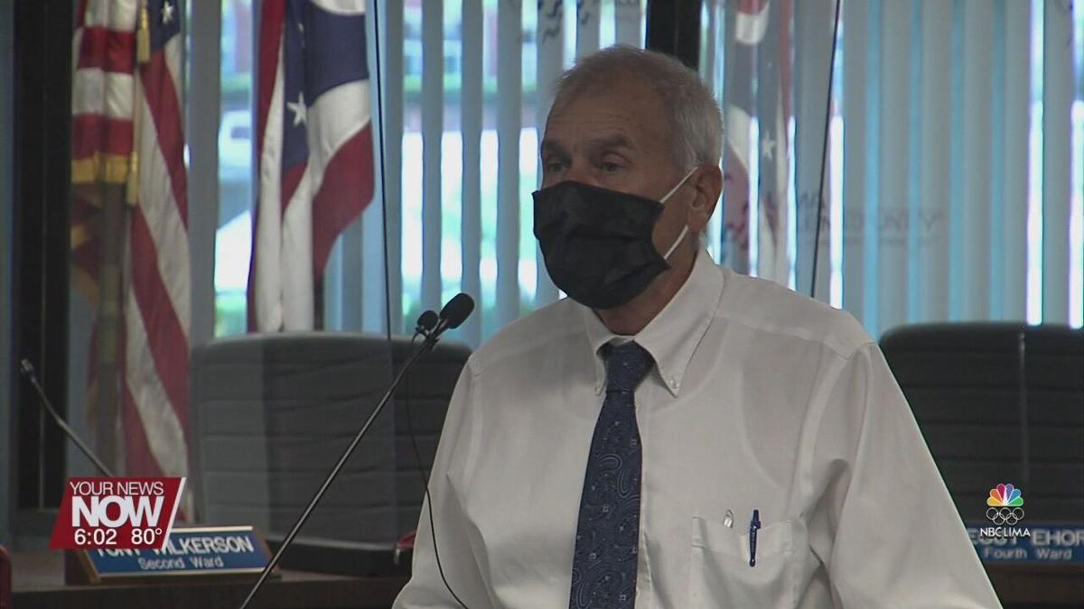 City of Lima following CDC guidelines of masking up to enter buildings