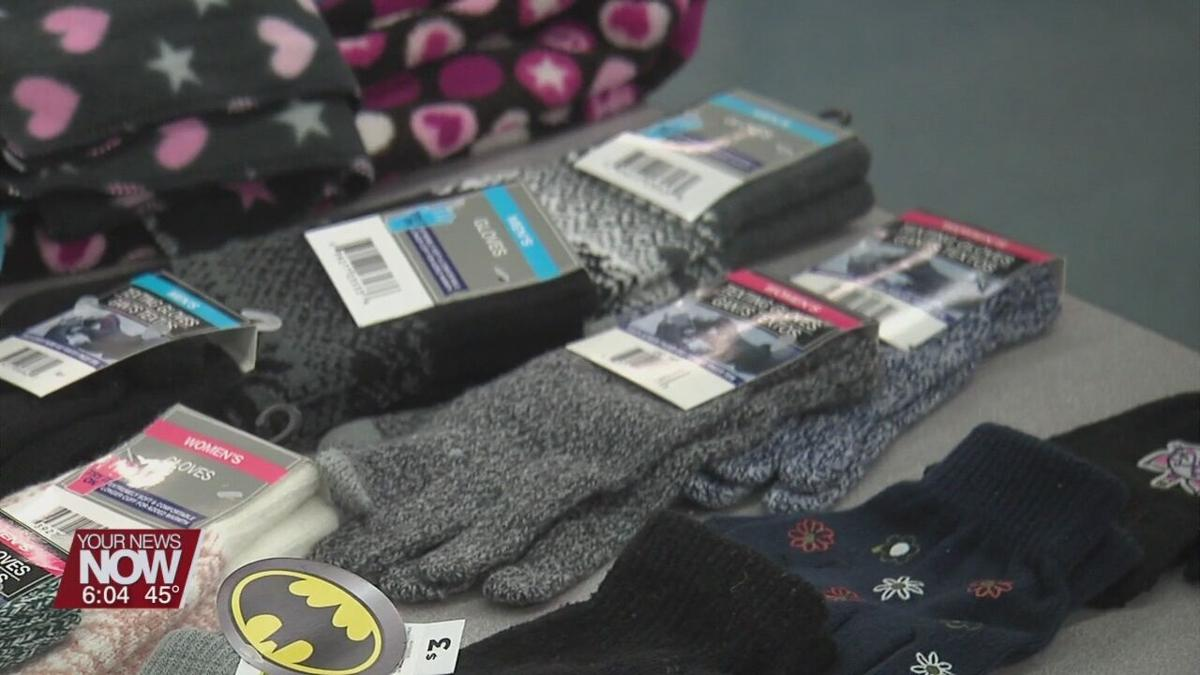 Students receive coats for school during Saturday event
