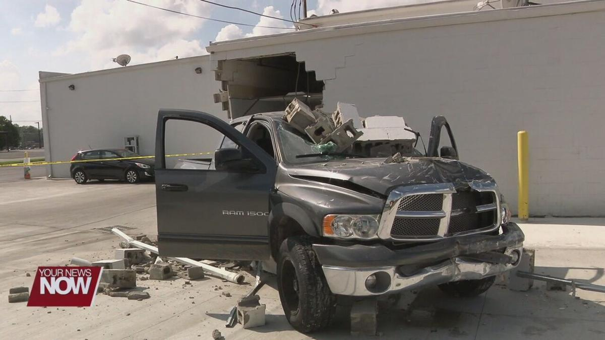 Pickup driver hits Lima strip mall while he is being assaulted