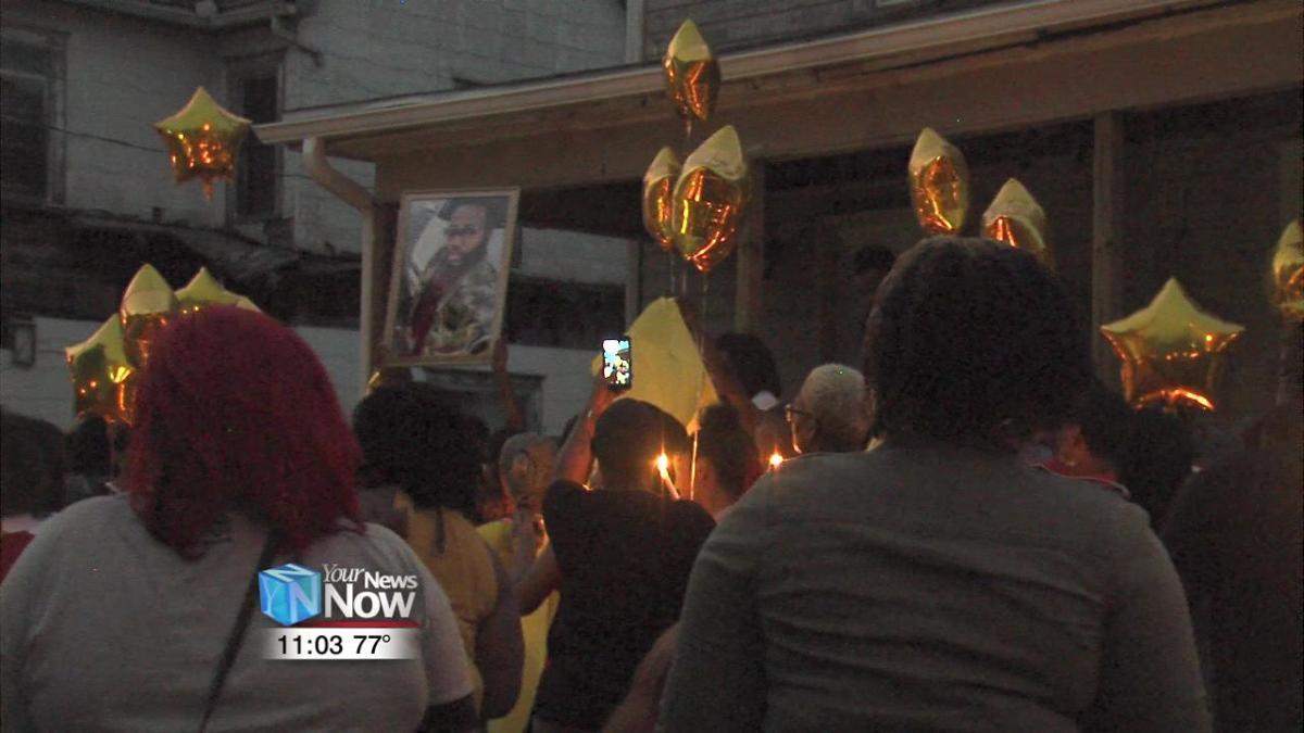 Candlelight vigil held for murdered correctional officer.jpg