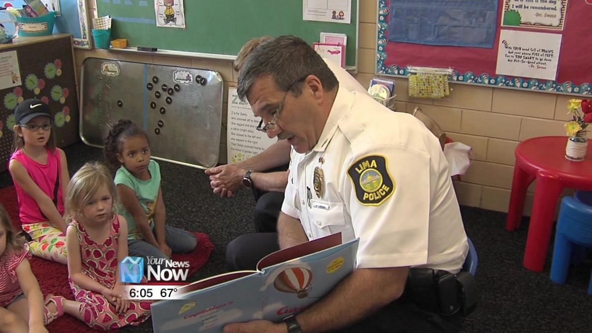 Local police chiefs read to students to emphasize the important of early education 2.jpg