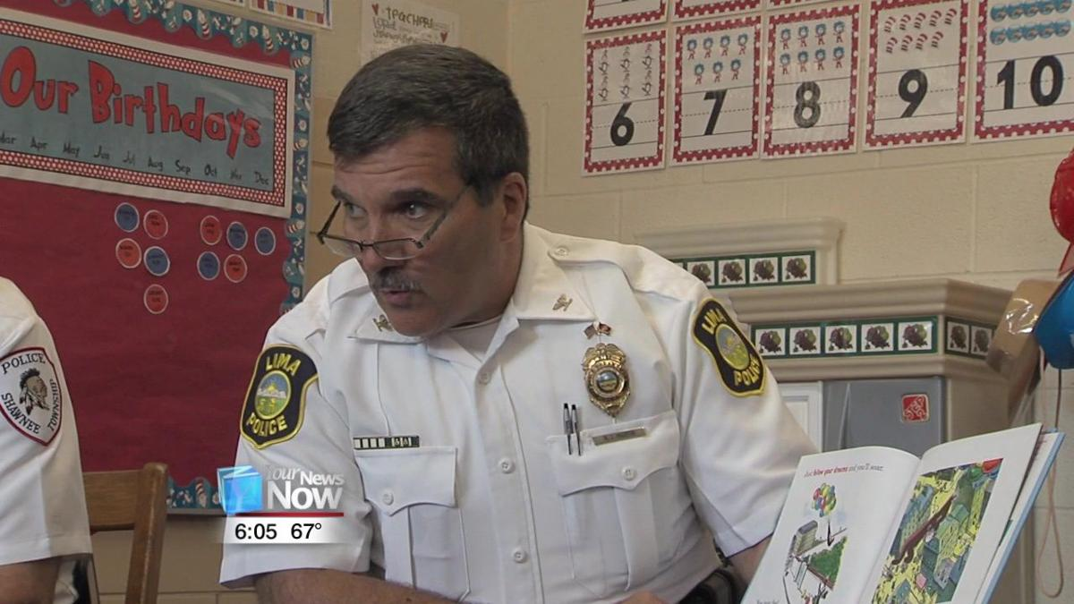 Local police chiefs read to students to emphasize the important of early education 1.jpg