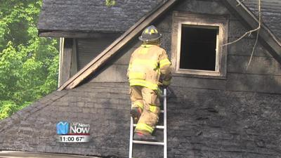 Duplex heavily damaged after grill catches porch on fire 1.jpg