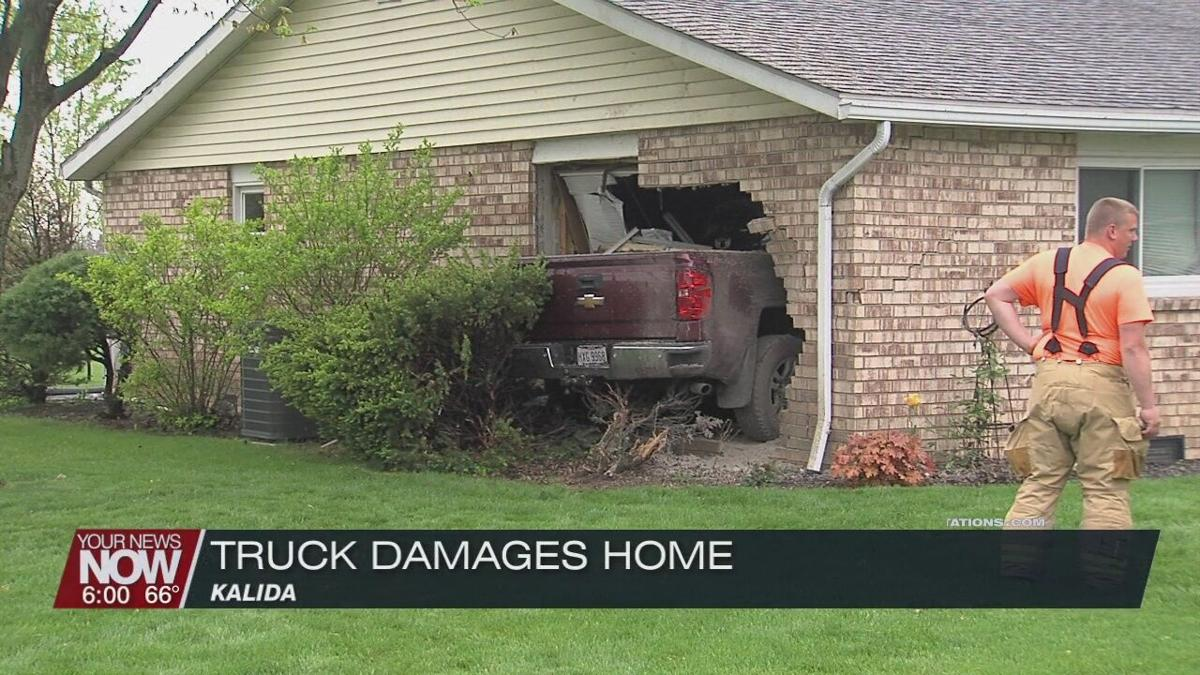 Truck crashes into home in Kalida